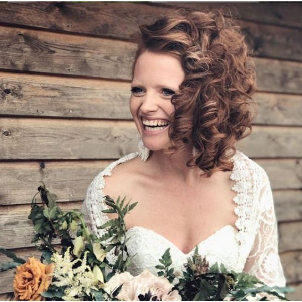 Curly Side Swept Hairdo bridal hairstyles