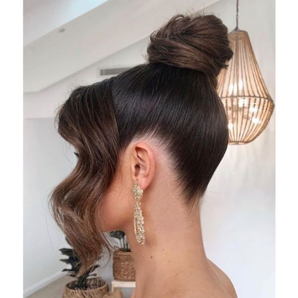 High Bun with Falling Strands Hairstyle