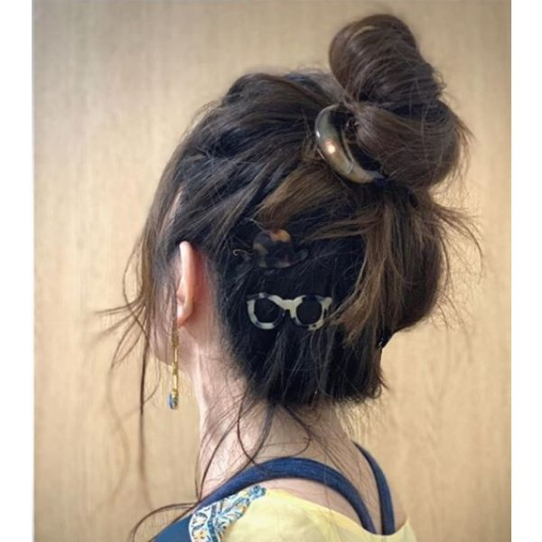 High Messy Bun with Falling Strands