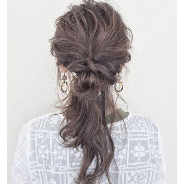 Knotted Ponytail with Messy Strand Hairstyle
