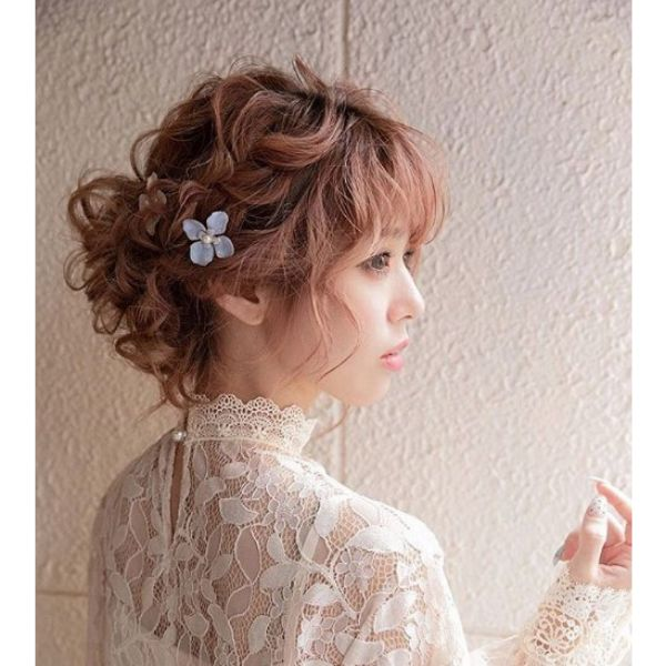 Loose Crown Braid with Falling Strands Hairstyle