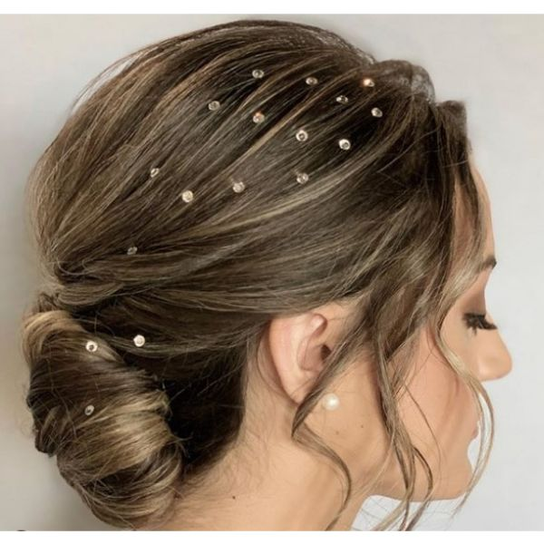 Low Bun with Airy Texture Styles with Swarovski crystals