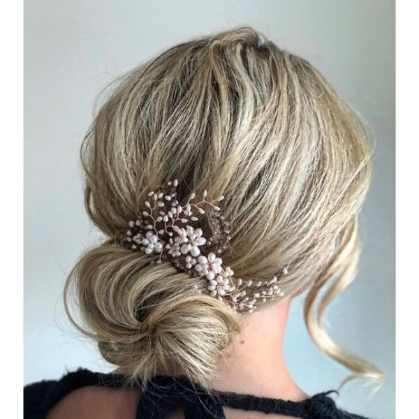 Low Bun with Falling Strands Hairstyle