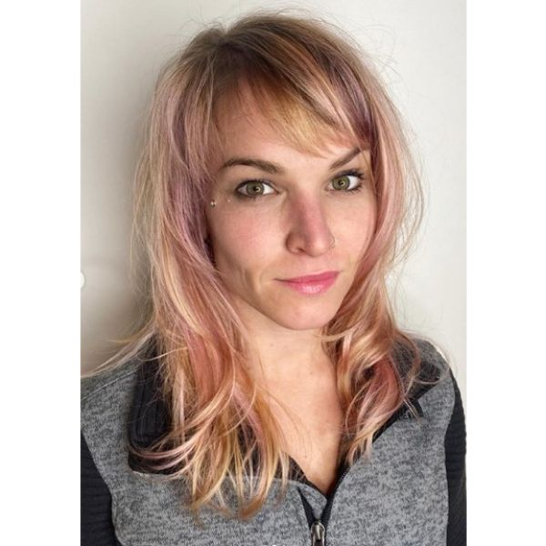 Medium Length Pastel Hairstyle with Straight Bangs