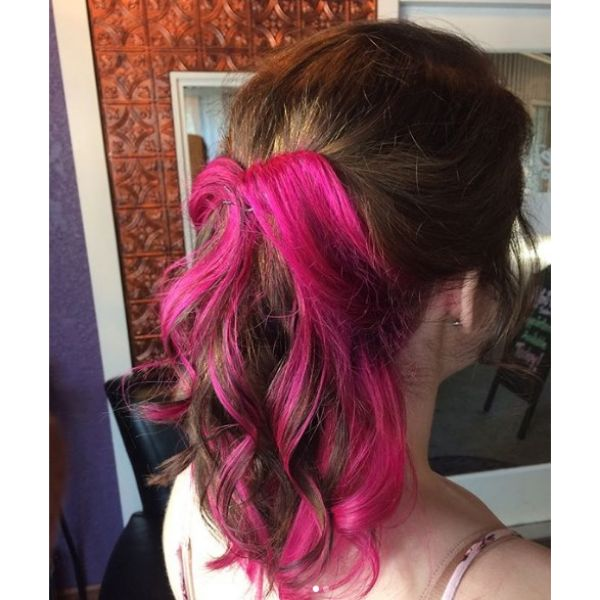 Mid Length Hairstyle with Twisted Pink Highlights