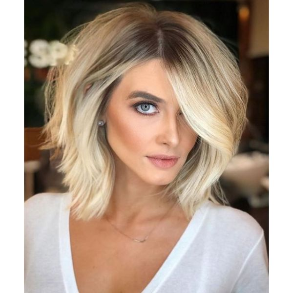 Mid Length Voluminous Hairstyle with Wavy Strands