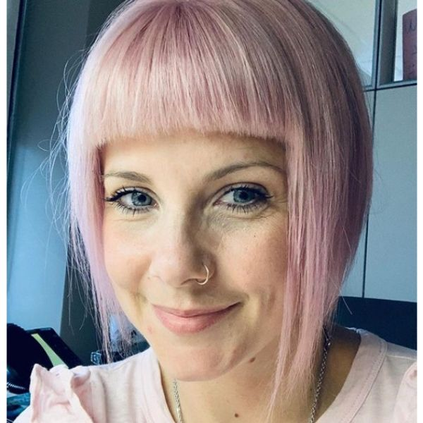 Pastel Pink Bob Hairstyle with Straight Bangs