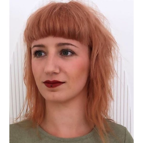 Peach Mullet Hairstyle with Straight Bangs Mid Length Hairstyle