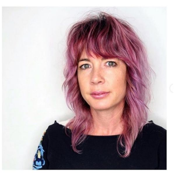Pink Shag Hairstyle with Heavy Bangs