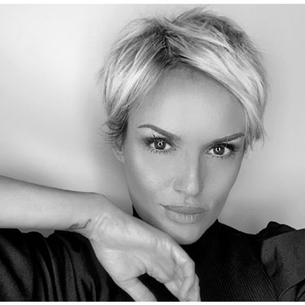 Platinum Blonde Layered Pixie Hairstyle