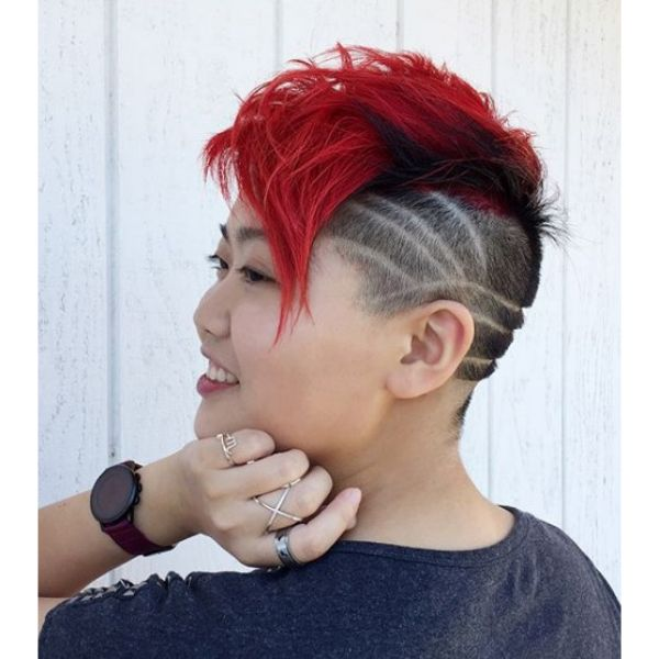 Punk Mohawk with Shaved Sides and Artistic Razor Pattern