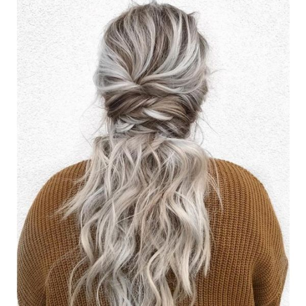 Textured Undone Ponytail with Falling Strands bridal hairstyles