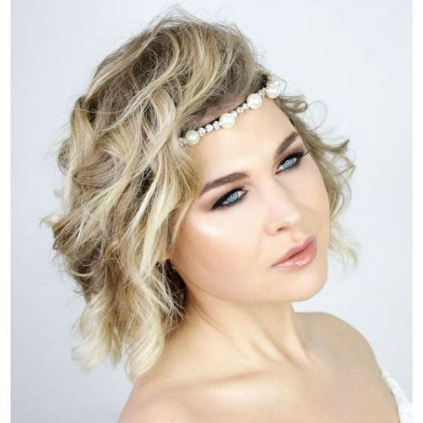 Wavy Messy Side-swept Hairstyle with Headband bridal hairstyles