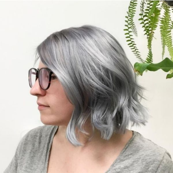 Ashy Gray Hairstyle with Waves Haircut