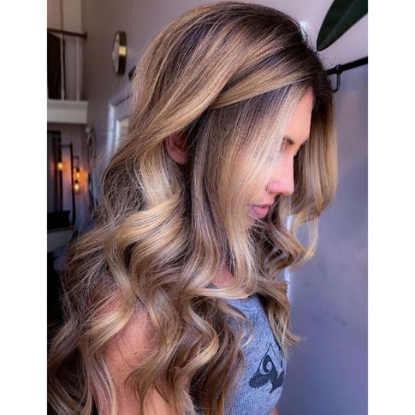 Bright Blonde Balayage Hairstyle With Flowy Curls