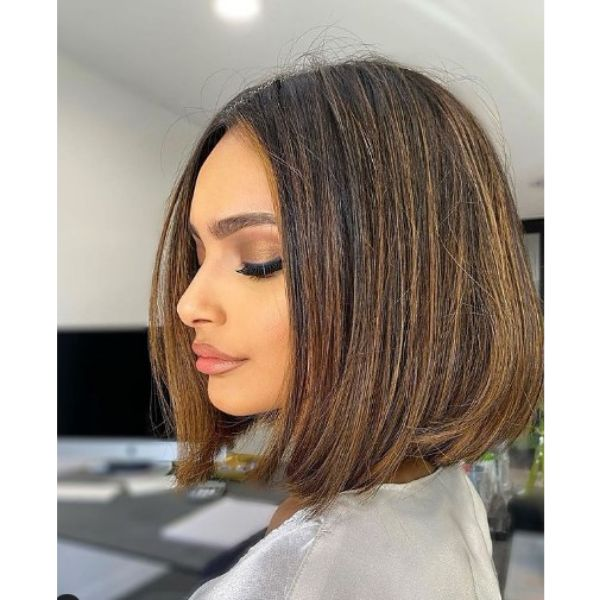 Classic Bob Haircut with Subtle Blonde Highlights