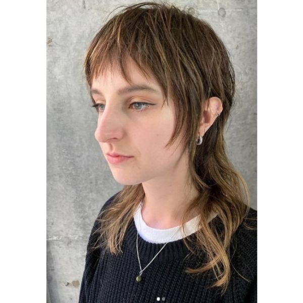 Extra long Mullet Haircut with Subtle Highlights