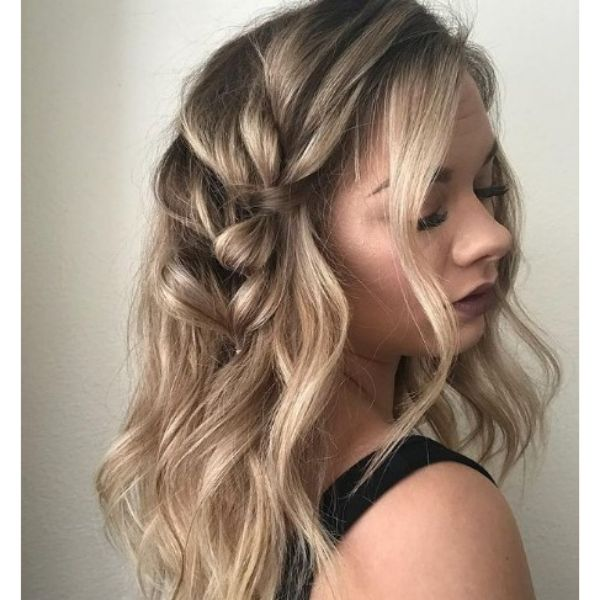 Long Curly Feathered Hairstyle with Accent Braid