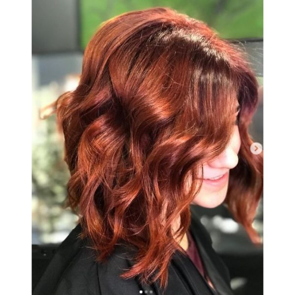 Shinny Red Haircut for Wavy Hair