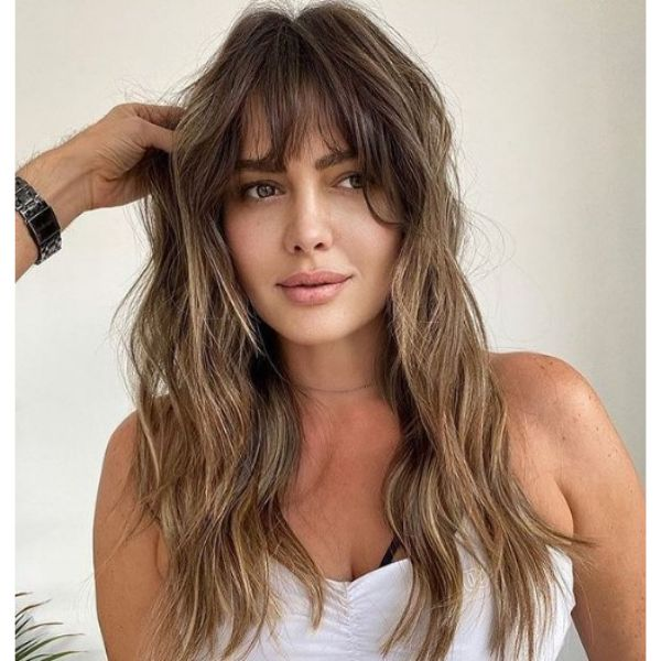Sunkissed Balayage for Long Shag Hairstyle with Thick Bangs