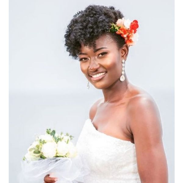 Afro Wedding Hairstyle For Faux Hawk With Colorful Flower