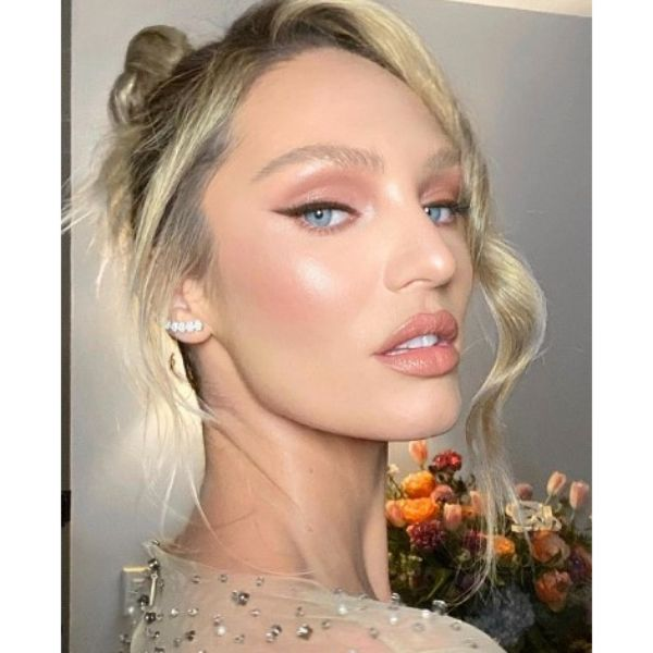 Angela Candice's Glam Hairstyle For Blonde Hair With Falling Strands