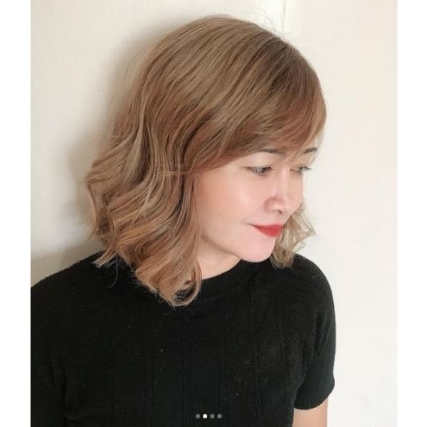 Ashy Blonde Medium Haircuts For Wavy Hair with Side Bangs