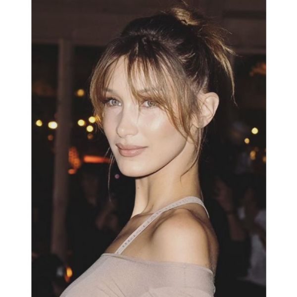 Bella Hadid's Oval Face With Bangs Hairstyle