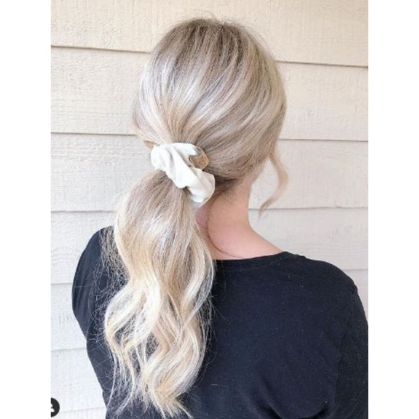 Blonde Low Ponytail With White Scrunchie