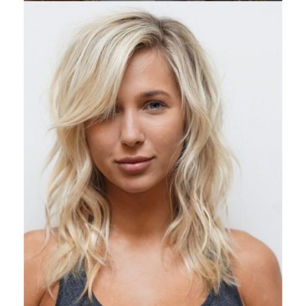 Blonde Medium Long Haircuts For Wavy Hair With Side-swept Bangs