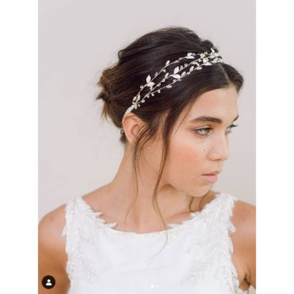 Bridal Updo With Falling Strands And Delicate Headband