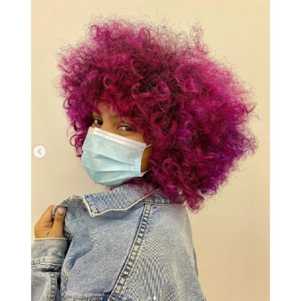 Bright Magenta Short Curly Hairstyle