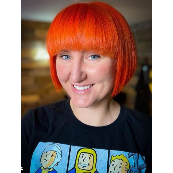 Bright Orange Bob Hairstyle With Thick Bangs For Oval Face