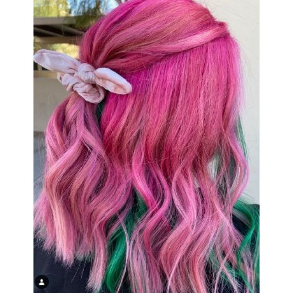Bright Pink Colored Medium Haircut With Green Underliights and Half Ponytail