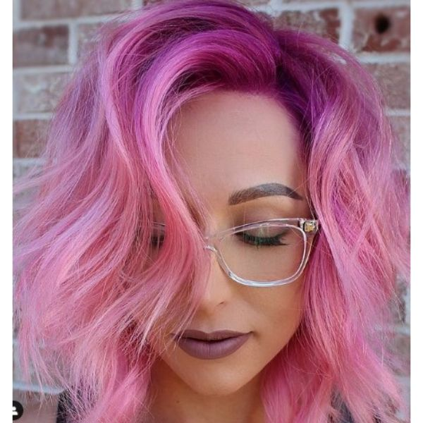 Bright Pink Wavy Haircut With Magenta Roots