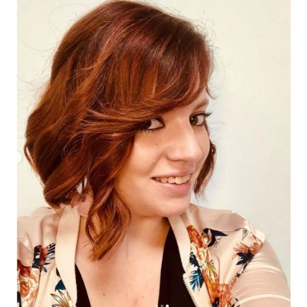 Cinnamon Red Medium Haircut For Wavy Hair With Side Swept Fringe