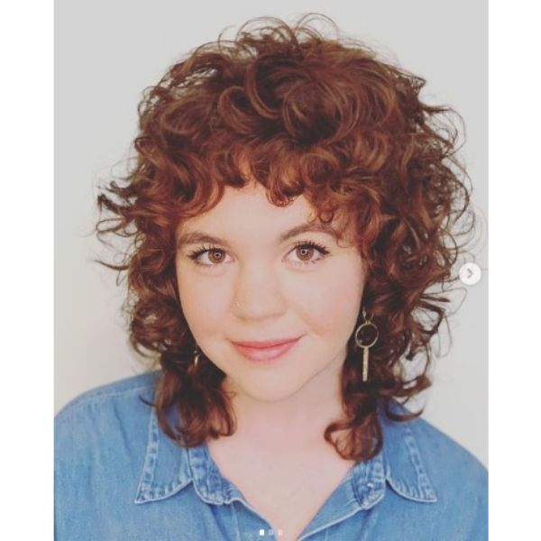 Curly Shag For Short Red Hair With Face Framing Bangs