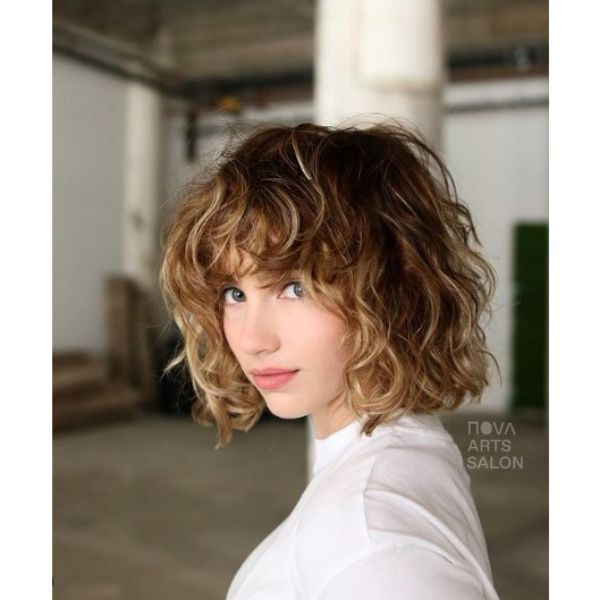 Curly Wavy Bob With Blonde Highlights And Curly Bangs
