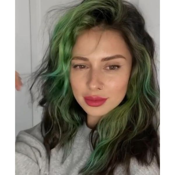 Dark Medium Haircut With Green Highlights And Messy Curls