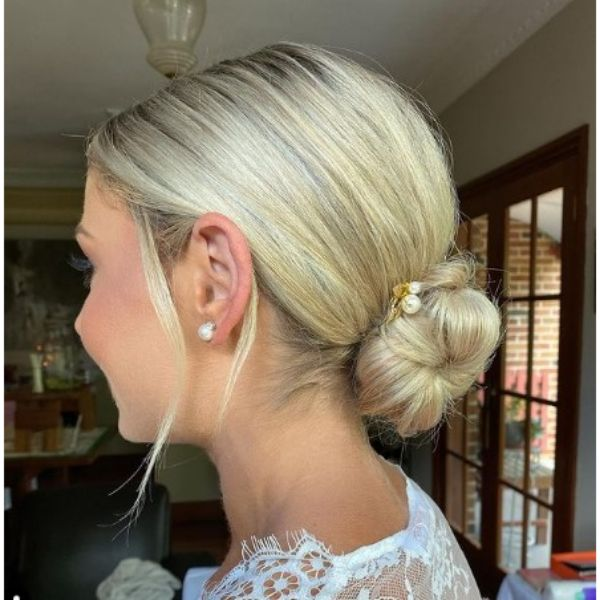 Elegant Low Chignon With Face Framing Pieces Hairstyle
