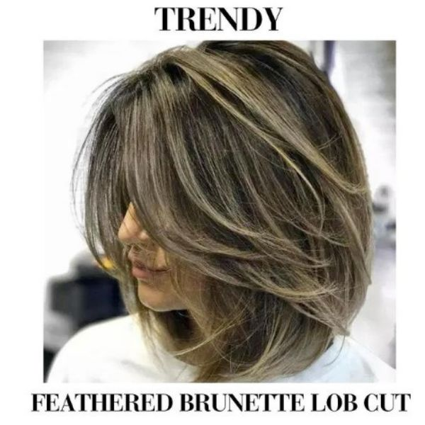Feathered Brunette Lob Haircut With Blonde Highlights