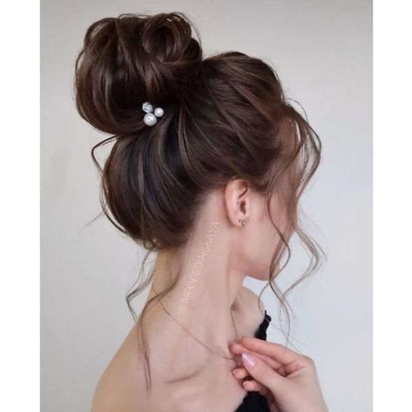 High Negligent Bun With Falling Strands And Beam Hair Pin