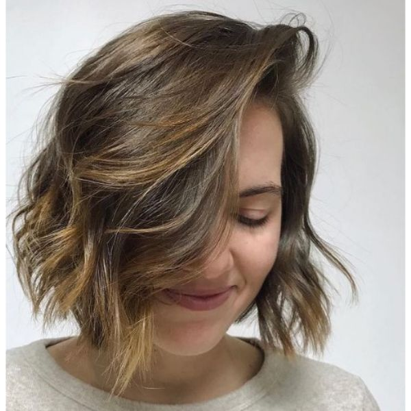 Honey Colored Medium Haircut For Wavy Hair With Deep Side Part