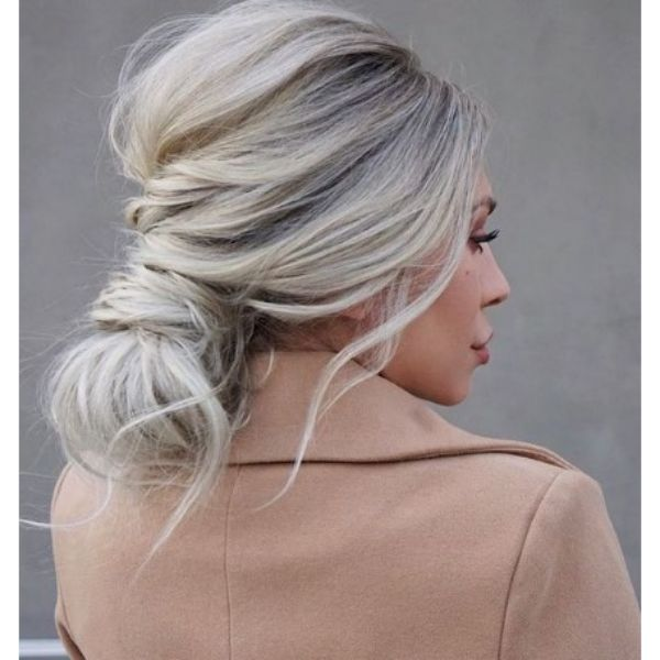 Knotted Bun Hairstyles For Blonde Hair With Falling Strands