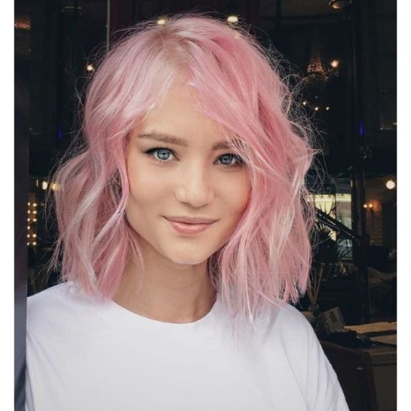 Light Pink Wavy Haircut With Messy Curls