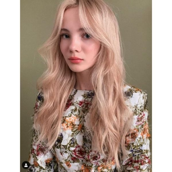 Long Swoopy Layered Hairstyle For Strawberry Blonde Hair