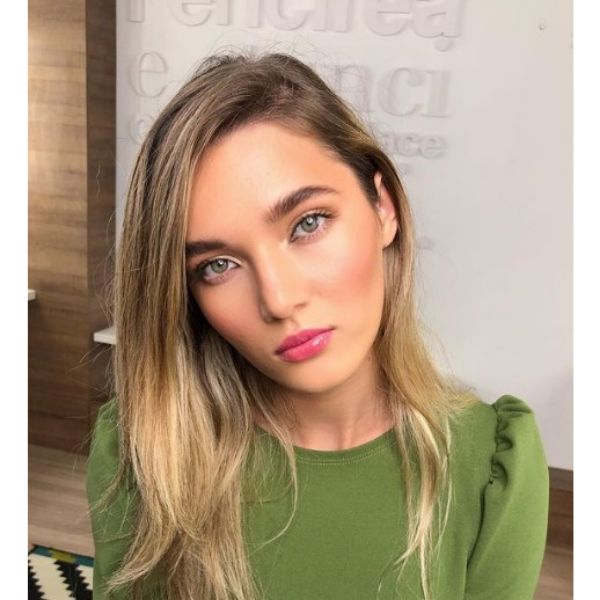 Long Warm Blonde Haircut With Side Part