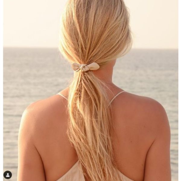 Low Ponytail With Small White Ribbon For Blonde Hair