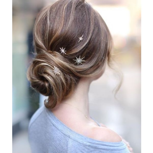 Low Swirly Bun Hairstyle For Medium Hair With Star Pins