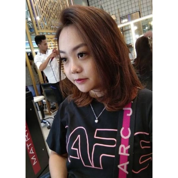 Medium Layered Haircut With Deep Side Part
